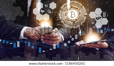 Bitcoin and cryptocurrency investing concept - Businessman using mobile phone application to trade Bitcoin BTC with another trader in modern graphic interface. Blockchain and financial technology. #1186450261