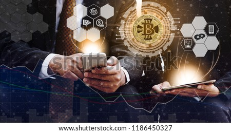 Bitcoin and cryptocurrency investing concept - Businessman using mobile phone application to trade Bitcoin BTC with another trader in modern graphic interface. Blockchain and financial technology. #1186450327