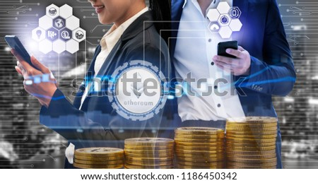 Ethereum and cryptocurrency investing concept - Businessman using mobile phone application to trade Ethereum ETH with another trader in modern graphic interface. Blockchain and financial technology. #1186450342