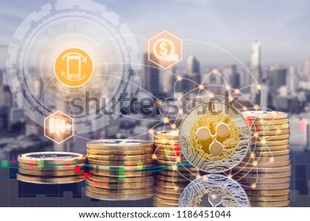 Ripple XRP and cryptocurrency investing concept - Physical Ripple coins with city background and exchange market trading price chart. Blockchain and financial technology. #1186451044