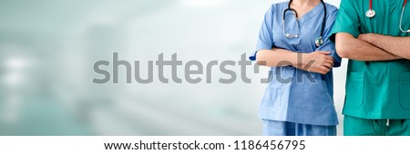 Doctor and nurse in hospital. Healthcare and nursing service.