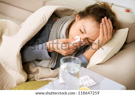 Sick Woman.Flu.Woman Caught Cold. Sneezing into Tissue. Headache. Virus .Medicines Royalty-Free Stock Photo #118647259