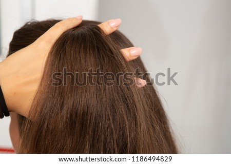 Concept of female vanity, woman with hand in her hair #1186494829