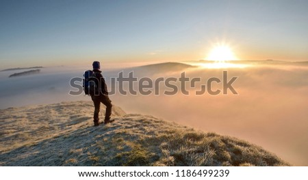 man on the top of the mountain #1186499239