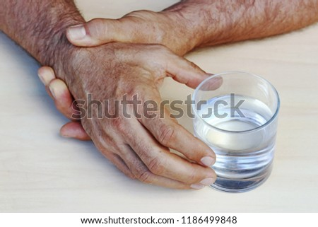 The hands of a man with Parkinson's disease tremble. Strongly trembling hands of an older man  #1186499848