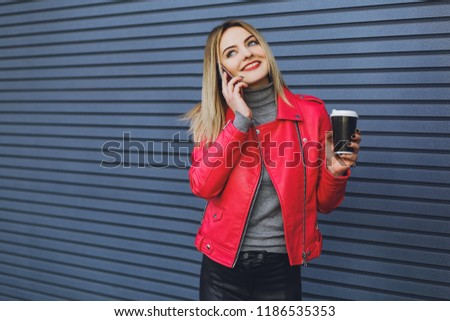 Young beautiful girl drinks coffee and talking on the phone  #1186535353