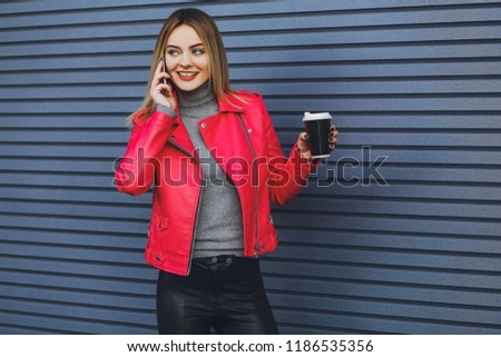 Young beautiful girl drinks coffee and talking on the phone  #1186535356