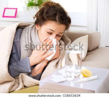 Flu or Cold. Sneezing Woman Sick Blowing Nose. Royalty-Free Stock Photo #118653634