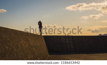 Photographers take pictures of the beppu bay in the Kyushu region. On the tsunami wall