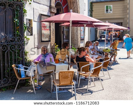 Salzburg, Austria, on August 17, 2018. the picturesque street in the old city. People eat and have a rest in street cafe #1186712083