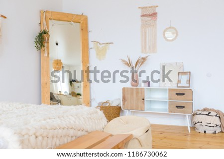 cute cozy light interior design of the apartment with a free layout of the kitchen and bedroom areas. a lot of windows, a wooden floor and a hanging swing. #1186730062