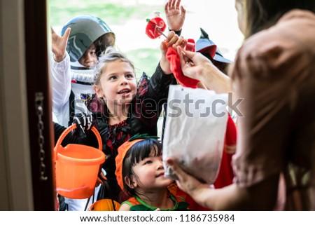 Little children trick or treating on Halloween #1186735984