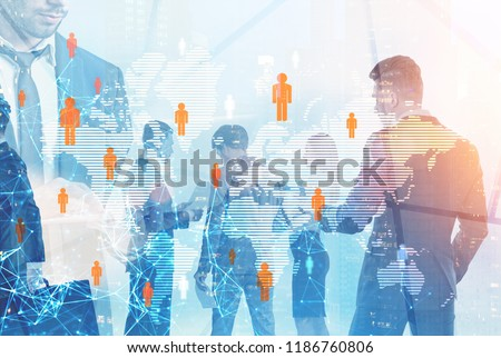 Diverse business team members walking and standing over cityscape background and global people network foreground Toned image double exposure mock up Elements of this image furnished by NASA #1186760806