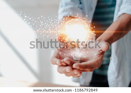 concept creativity with bulbs that shine glitter. Royalty-Free Stock Photo #1186792849