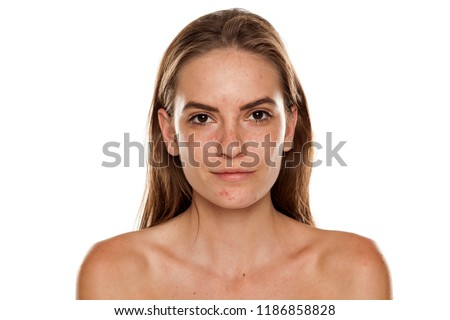 Portrait of young beautiful shirtless woman with no makeup on white backgeound #1186858828
