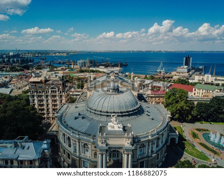 Bird's eye view of a beautiful building, port and sea. #1186882075