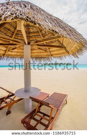 The beach sun beds on luxury beach tropical island , Sanya, Hainan Province, China. Happy island lifestyle .