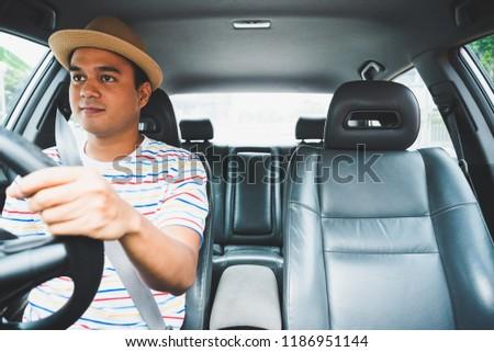 Young asian man driving car. #1186951144