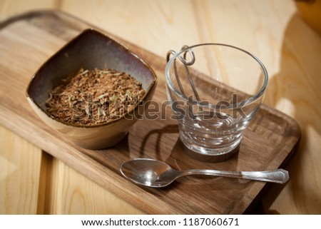 Arabian spiced coffee, grains smashed with spices on a bowl on a wooden background with empty coffee cup and tea spoon. Gourmet coffee from around the world concept. #1187060671