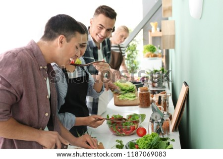 Friends cooking together in kitchen #1187069083
