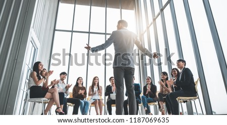 Business people clapping hands during meeting in office for their success in business work Royalty-Free Stock Photo #1187069635