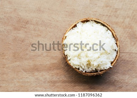 Cooked rice in Coconut Shell on banana leaf #1187096362