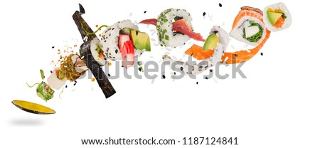 Pieces of delicious japanese sushi frozen in the air. Isolated on white background #1187124841