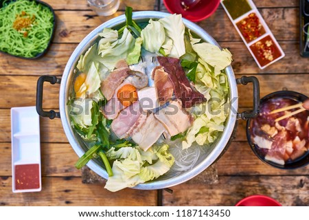 Thai barbecue pork (Moo-Ka-Ta)  - famous Thai local food with need to do own cooking - food photography concept