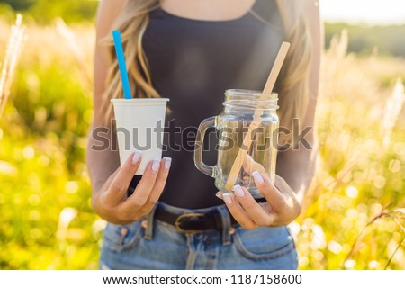 Zero waste concept. Use a plastic glass and plastic straw or mason jar and bamboo straw. Zero waste, green and conscious lifestyle concept. Reusable on the go drink container ideas #1187158600