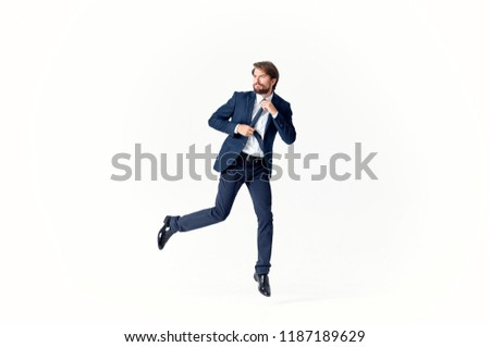 a man in a suit on a light background                              #1187189629