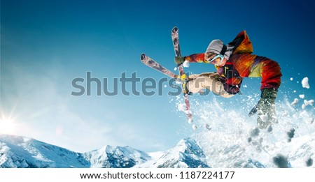 Skiing. Jumping skier. Extreme winter sports. #1187224177