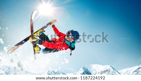 Skiing. Jumping skier. Extreme winter sports. #1187224192