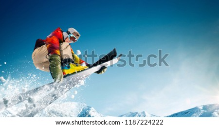 Skiing. Jumping skier. Extreme winter sports. #1187224222