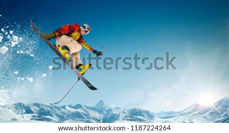 Skiing. Jumping skier. Extreme winter sports. #1187224264