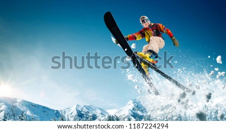 Skiing. Jumping skier. Extreme winter sports. #1187224294