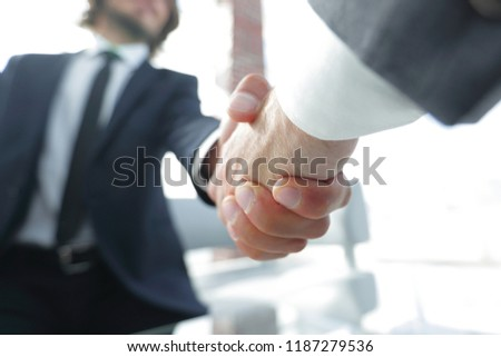 Close-up of two business people shaking hands #1187279536