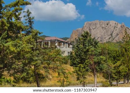 landscape house near a road in a mountainous area #1187303947