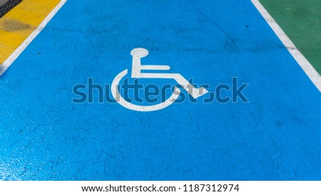 Wheelchair sign in the parking lot. #1187312974