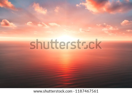 Bright orange sky and light of the sun. Sky background on sunset. Nature composition. Panoramic sunset sky background. Sunrise sky with lighted clouds. Beauty evening sunrise.