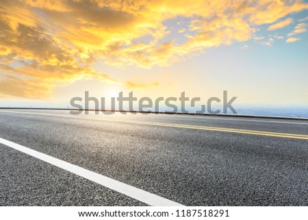 Panoramic skyline and buildings with empty road #1187518291