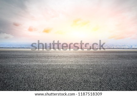Panoramic skyline and buildings with empty road #1187518309