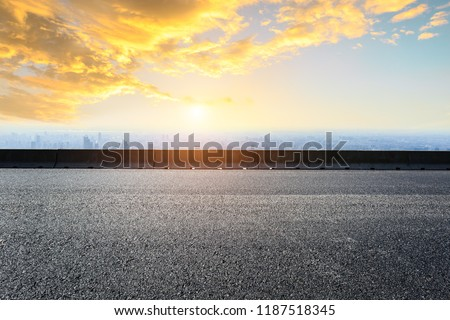Panoramic skyline and buildings with empty road #1187518345