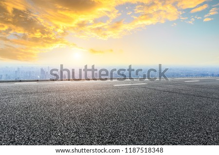 Panoramic skyline and buildings with empty road #1187518348