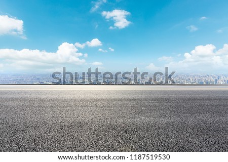 Panoramic skyline and buildings with empty road #1187519530