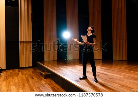 Young actor in a theater. Royalty-Free Stock Photo #1187570578