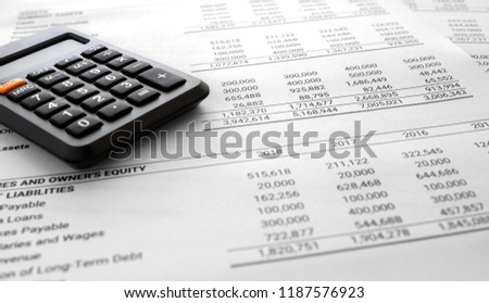 Financial statement / Balance sheet summary report and calculator, pen, laptop pc on auditor's desk. Accounting and accounts concept. document is mock-up. #1187576923