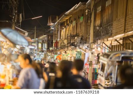Loei: September 15, 2018, tourists go shopping at night at Chiang Khan Walking street, near Kaeng Khut Khu, a tourist attraction along the Mekong River, close to neighboring countries (Laos), Thailand #1187639218