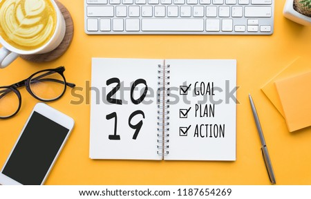 2019 new year goal,plan,action text on notepad with office accessories.Business motivation,inspiration concepts #1187654269
