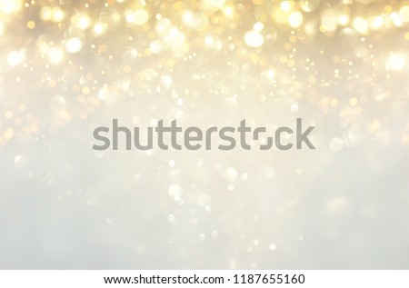 glitter vintage lights background. silver, gold and white. de-focused #1187655160