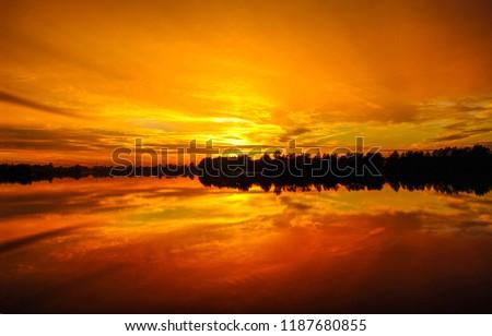 Sunset orange lake water reflection landscape. Sunset water reflection. River sunset orange view. Sunset river water reflection panorama #1187680855